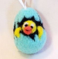 Felt Easter Egg  Miniature ornament    This mini ornament is just a shade over 1 1/2 high (not counting the ribbon) and about 1 wide. It is solid