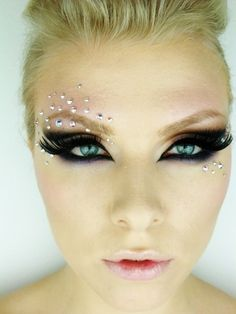 Exquisite dramatic cut crease  with rhinestone accents