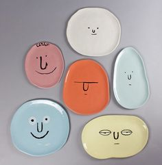 Each of the plates in the Face Plates set has a different face and is a different color. Each of the plates in the Face Plates set has a different face and is a different color. Handmade Gifts For Men, Handmade Christmas Gifts, Handmade Home, Handmade Ceramic, Handmade Pottery, Ceramic Clay, Ceramic Pottery, Pottery Art, Slab Pottery