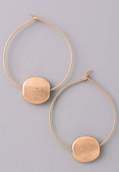These earrings are such a fun twist on the typical hoop earring! Not to mention, can we love this matte gold anymore?! Take your jewelry to the next level with this fun pair!