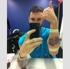 Adam Levine (Maroon 5, The Voice, American Horror Story: Asylum) showing off his tattoos!