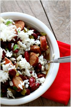 Easy slow cooker recipe for Louisiana red beans and rice--not too spicy but plenty of flavor!