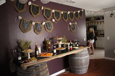 Wine tasting table with burlap and chalkboard runner. Burlap and chalkboard bunting and tons of win