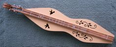 Learned to play the mountain dulcimer at the age of 60 (not this one but a lovely Cripple Creek Dulcimer with hummingbirds from Colorado).