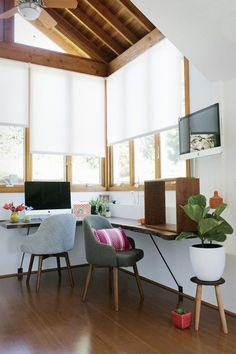"Studio Tour - Design*Sponge ""Our custom walnut desk by Jared Rusten is by far our favorite piece in the office. Jared is an incredible woodworker, and he used a beautiful piece of salvaged walnut to make our desk. The desk fits the small space perfectly while still being large enough to fit two workstations, one of which had to be standing since Adm has a bad back. Jared managed to bring the outdoors inside just the way we wanted.""  Studio Tour - Design*Sponge"