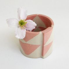 One of my favourite little pots by one of my favourite London ceramicists @lazyglaze. The pink triangles are not just decoration they are integral to the clay mix so they appear on both the inside and outside of the pot.  . . . #ceramics #ceramic #pink #triangles #craft #handmade #interiorstyle #pottery #maker #interiordesign #homewares #interiors #slowdesign