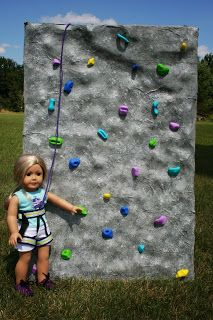 Arts and Crafts for your American Girl Doll: Rock climbing wall for American girl dolls •just paint a cardboard box grey/white •glue on colored beads or colored/painted tiny rocks •glue a piece of ribbon to the top then make a detachable harness by rapping ribbon around your doll use Velcro to detach.