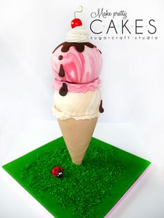3D Ice Cream cone cake - two scoops! - This is my sweet little version of the stand up ice cream cone cake, a perfect summer cake for us right now in New Zealand! I did take photos in my little photo booth, but thought I'd share the version with my little girl posing to show scale! Needless to say she was thrilled with it. Happy 2nd birthday baby girl!!! xoxo  *Strawberry, vanilla and chocolate caramel mudcake flavors, covered in white ganache and fondant. Coconut grass on fondant board…