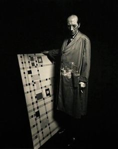 Artist Piet Mondrian standing next to his last completed painting. [::SemAp::]