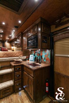 The combination of turquoise and the dark wood of this trailer give an upbeat and warm welcoming feeling for this home away from home.