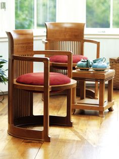 "Taliesin Barrel Chair  Prominent in Wright's own residence ""Taliesin"" in Spring Green, Wisconsin, this signature chair is comfortable, compact, and perfect as a stand alone or as a dining room chair."