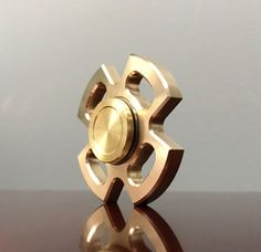The 4 Leaf Brass Fidget Spinner: Very nice and inexpensive metal fidget spinner. U.S.A made. Single bearing, small and easy to spin. Great for kids or adults, fit in any small pocket or bag. Unfocused? Restless? Fidgety? Find yourself biting your nails or chewing on pens? Aptly named the Fidget Spinner, this device not only combats nasty habits but also aids in concentration and focus. With recent studies correlating fidgeting with improved brain function the idea has gained wide spread…