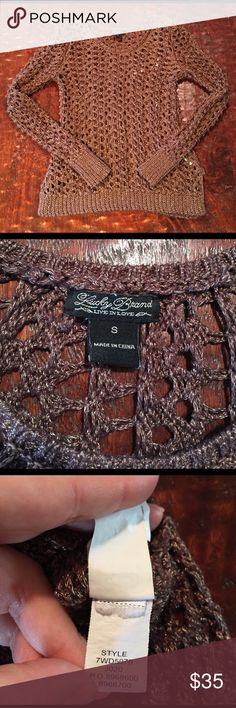 """Lucky Brand Metallic Open Weave Sweater Small Lucky Brand Metallic Open Weave Sweater. Sweater is 24"""" from shoulder to hem. Bust measures 13"""" laying flat. Sweater is in great condition. The laundry tag is the only part of the sweater with any sign of wear. It is missing the fabric content and is crumpled. This is visible in pics. Actual sweater has no flaws. Comes from a Smoke Free/Pet Friendly home. Offers always welcome. Lucky Brand Sweaters Crew & Scoop Necks"""