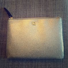 Kate Spade Authentic Silver Mini Pouch NWT NWT silver Kate Spade mini pouch. Absolutely gorgeous!! Comes with tag and care card. Shiny glittery and stunning ✨ zippered pouch with two pockets inside. kate spade Bags Clutches & Wristlets