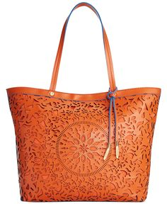 Intricate cutouts make this Carlos by Carlos Santana Kailee shopper bag a total work of art