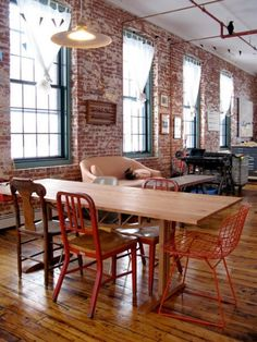 Modern loft with brick - notice the bird perched on the exposed pipe <3