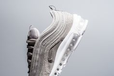The Nike Air Max 97 Cobblestone is introduced and set to drop at select Nike stores on August 1st.