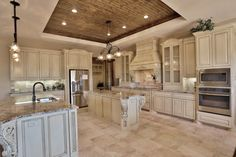 """This home was designed by Stonebridge  and was featured in the Big Country Home Builder's Association 2014 Parade of Homes.  Its """"Texas Tuscan"""" exterior is adorned with a combination of coordinating stone, stucco and brick.  Guest pass through a street-side courtyard and are welcomed by a turret formal entry.  At 2,858 square feet, this home includes 4-bedrooms, master courtyard, tech center and outdoor fireplace."""