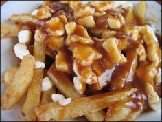 Poutine. Hello beautiful, oh how I have missed your crispy fries, hot sauce, gooey cheesy deliciousness!!! @Sara Fox @Lacey Perkins...get thee to Montreal. Get a poutine. Now.