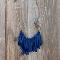 15 Easy Ways to Turn T-Shirts into Jewelry via Brit + Co.
