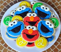 Remember my niece and nephew who adore Elmo? They turned two this past weekend and I made some Elmo and Cookie Monster cookies for their birthday party. Only this time, I had actual Elmo and Cookie…