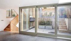 Chestnut. Contemporary timber sliding patio doors.