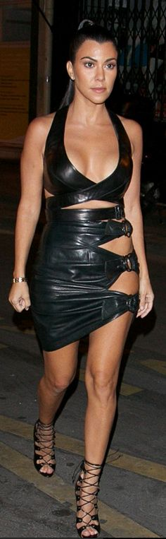 Who made Kourtney Kardashian's black leather cut out skirt and patent crop top?