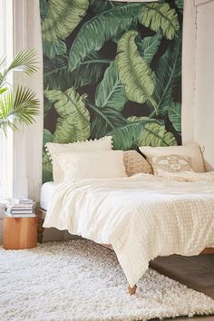 Love this monochromatic bed with the tropical print.