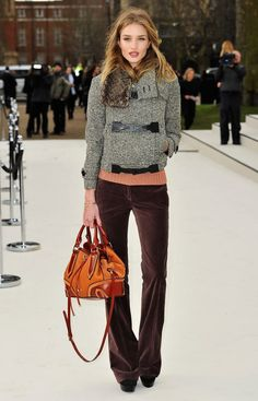 Rosie Huntington-Whiteley wearing a Burberry Prorsum Autumn/Winter 2012 tweed jacket and metallic tote