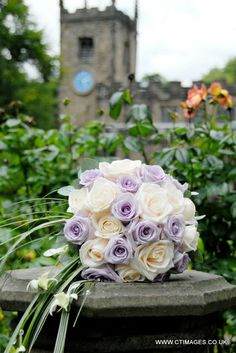 Pastel purples and cream wedding flowers