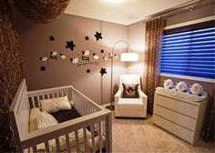Cute Baby Girls Room Pictures Collection 2014 : Fascinating Brown Baby Girls Room Design with Sheeps and Stars Wall Sticker also Beige Baby Crib and Metal Arc Lamp