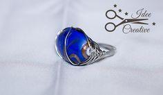 Anello wire con pietra azzurra e striature color oro. Realizzato a mano. Per info contattami