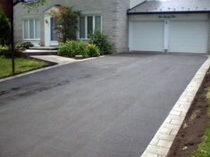 Invite guests in with the top 40 best driveway edging ideas. Explore unique border designs from brick to pavers, concrete, stone landscaping and beyond. Blacktop Driveway, Asphalt Driveway, Stone Driveway, Driveway Pavers, Diy Driveway, Driveway Ideas, Stone Landscaping, Driveway Landscaping, Landscaping Ideas