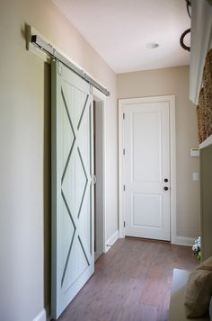 Barn door painted in a light blue green paint color. Farrow and Ball Light Blue 22