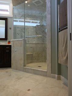 Traditional Bathrooms from Deena Castello on HGTV L-shape half wall for shower, bench, frameless glass Taupe Bathroom, Master Bathroom Shower, Bathroom Spa, Bathroom Ideas, Luxury Master Bathrooms, Guest Bathrooms, Shower Remodel, Bath Remodel, Bathroom Flooring