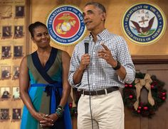 US President Barack Obama addresses troops with First Lady Michelle Obama at Marine Corps Base Hawaii in Kailua on December 25, 2016. Photo Nicholas Kamm/AFP/Getty Images.