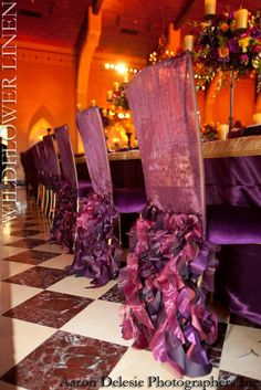Wedding Chair Swag Decorations - This ruffled chair cover in deep shades of glamorous maroon and purple achieves the perfect balance between plain and ruffled.