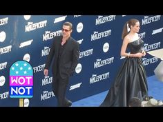 """Brad Pitt and Angelina Jolie Interact with Each Other on a Red Carpet: """"Brangelina"""" arrived on the red carpet hand in hand as Angelina Jolie promoted her film Maleficent at the El Capitan Theatre in Hollywood, Los Angeles. The couple, who split up in September 2016, posed for photographers together before Brad left her to be photographed alone © Atlantic Images"""