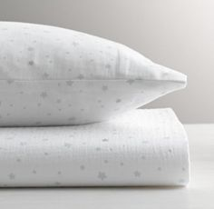 RH baby&child's Star Print Crib Fitted Sheet:Beloved for its light weight and superior softness, our cotton muslin fitted sheet and pillowcase are also naturally breathable. Each piece is washed for cozy comfort, and then printed with a scattering of stars in varying sizes.