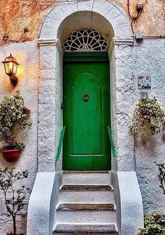 green door with iron iron transom