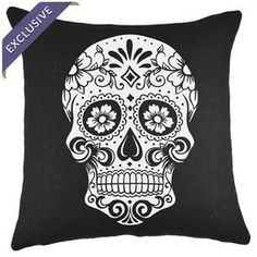 "Burlap pillow with a black and white sugar skull design. Handcrafted in the USA exclusively for Joss & Main.   Product: PillowConstruction Material: BurlapColor: Black and whiteFeatures:  Handmade by TheWatsonShopZipper enclosureMade in the USA Dimensions: 16"" x 16""Cleaning and Care: Spot clean. Do not iron"