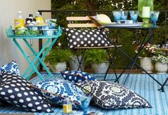Seating for All  A cramped space doesn't mean you have to forgo entertaining. Scatter all-weather pillows for casual souk-like seating.    —pinned from One Kings Lane