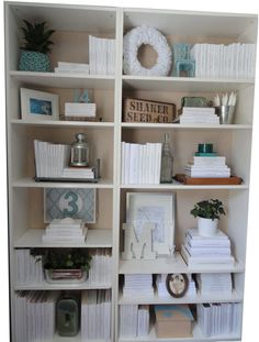 Great ideas for arranging bookshelves with tutorials on thepreciouslittlethingsinlife site.