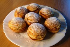 A Danish specialty, the Aebleskiver is type of filled doughnut made in a special cast-iron pan and dusted with powdered sugar. #Denmark #Christmas #HotelREZCHristmas