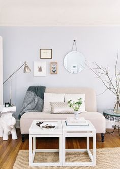 San Francisco studio apartment with pale blue walls and petite gallery wall
