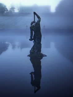 Neptune stands guard over a misty lake at dawn and a secret contained within.