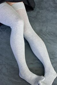 Extraordinary Thigh Highs - What's so extraordinary about solid-colored flat-knit thigh highs? Unprecedented stretch and comfort! These will fit legs of all sizes, short and slender to tall and curvy, as well as everything in between, and they'll look great doing it. We've searched for years to find socks that fit this well; now we have them, and you can too! Made in the USA.