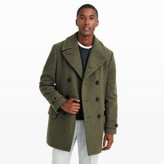A classic peacoat with military-inspired details, our lieutenant coat is crafted in a luxurious, durable wool in a versatile olive hue. Wool Tailored fit 34'' center back length, based on a size 40 Double-breasted pea coat; notch lapels; left lapel buttonhole; welt pockets at chest; front flap pockets; adjustable tabs at cuffs with button closures; single back vent Quilted lining; three interior slit pockets Dry clean Imported