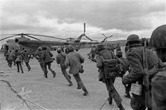 """""""This Is Not a Drill"""". Angola, 1982. Photograph by Ernesto Fernandez Nogueras. Cuban soldiers rush to deploy."""