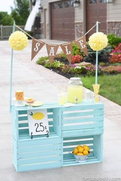 Lemonade Stand Ideas for kids. This DIY set up using crates is so cute. Love all of the colors too. The cubbies are perfect for storing decor and cups/extras in the back.